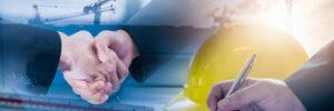 Affärsmän skakar hand efter överenskommelse för ny byggprojekt enligt kravspecifikationer.